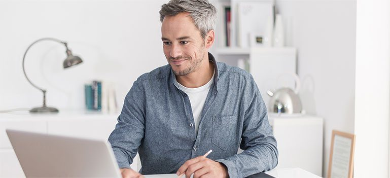 Male working at laptop
