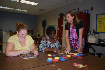 childcare students with blocks