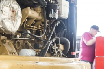 student working on diesel