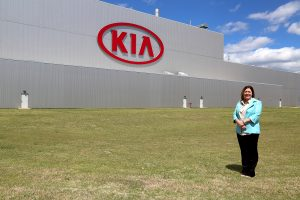 Heather Andrews standing in front of KIA