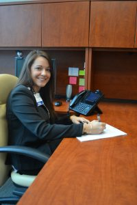 Kelley McPherson at a desk