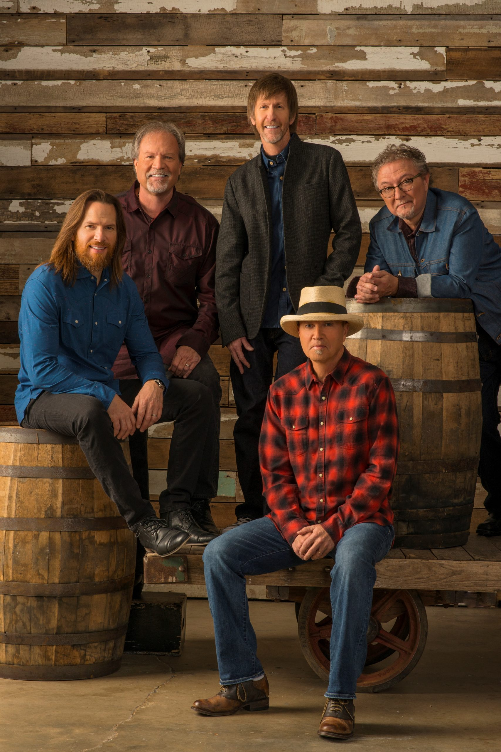 Sawer Brown band sitting with barrels
