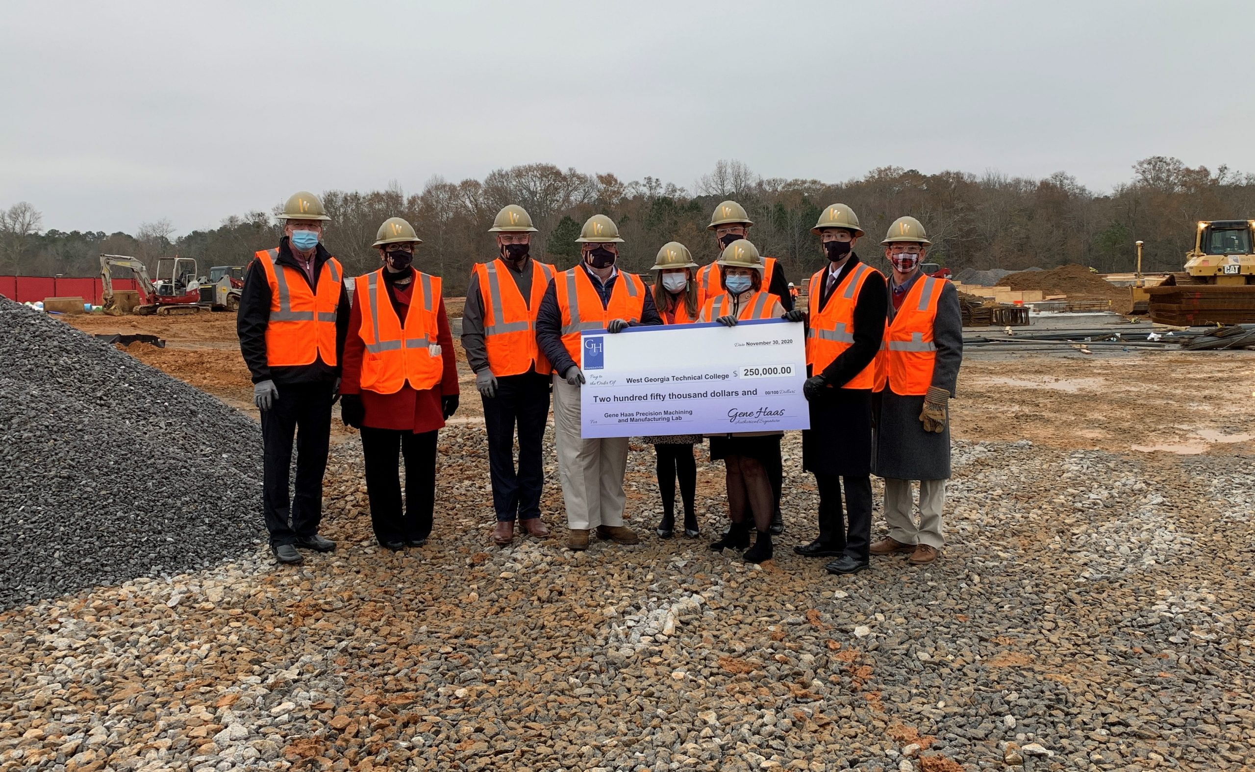 Gene Haas Foundation check presentation at construction site