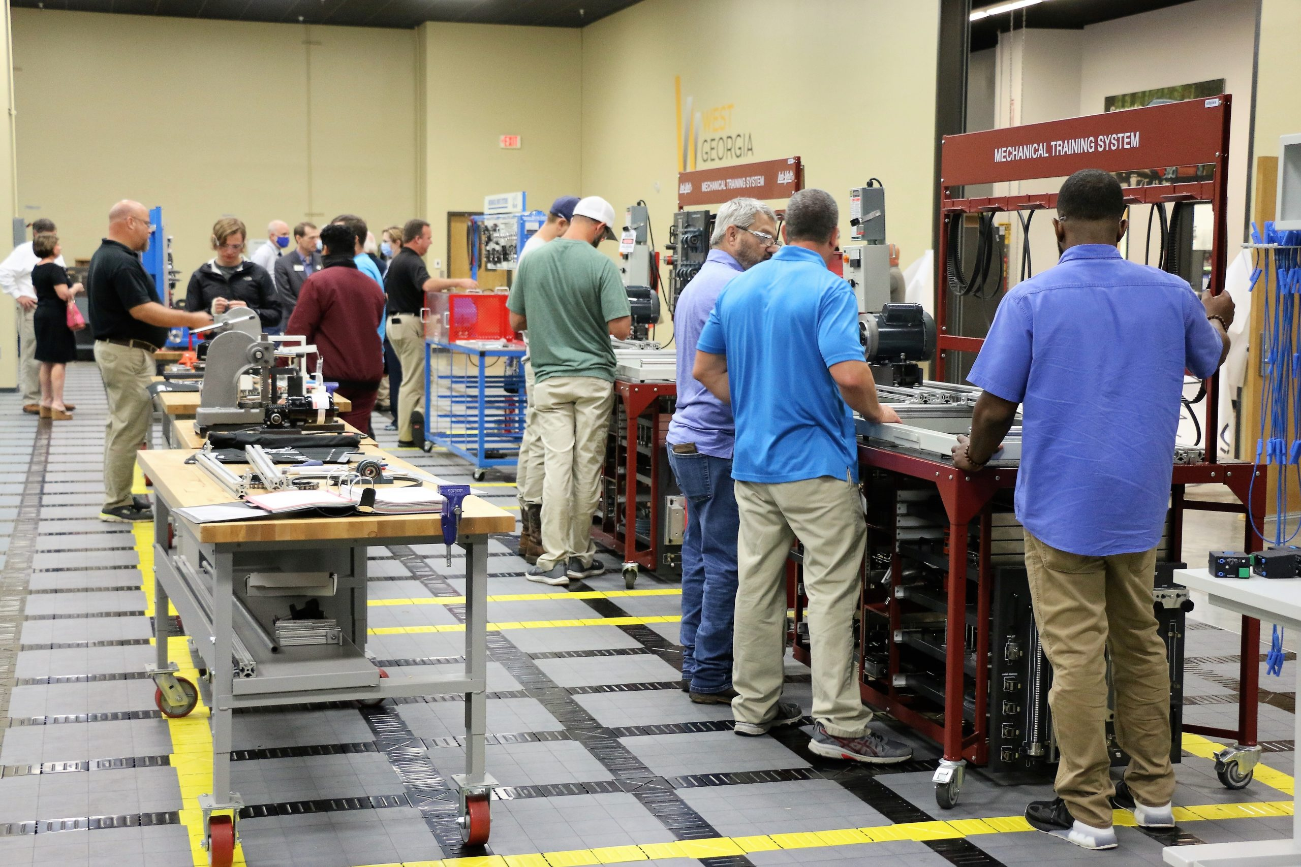 WGTC students work on equipment inside the Precision Manufacturing Lab on the College's LaGrange Campus